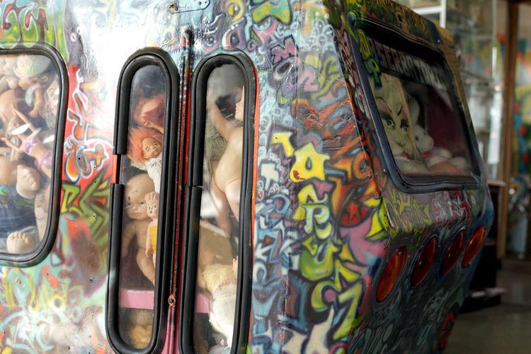 Close-up of graffiti on glass window