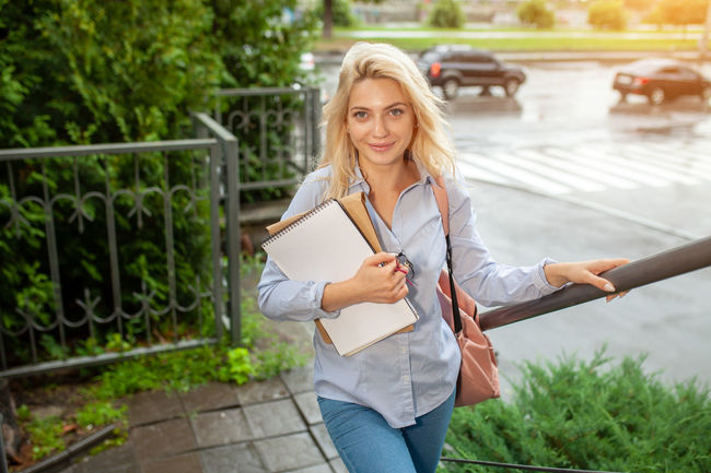 Young student outdoor Campus Happy Portrait Of A Woman Student Student Life Students Day University Campus Back To School Beautiful Woman Blonde Girl College Education European Woman Exam Girl Girl With Backpack Hair Hairstyle Knowledge One Person Outdoors School Smile University Young Adult