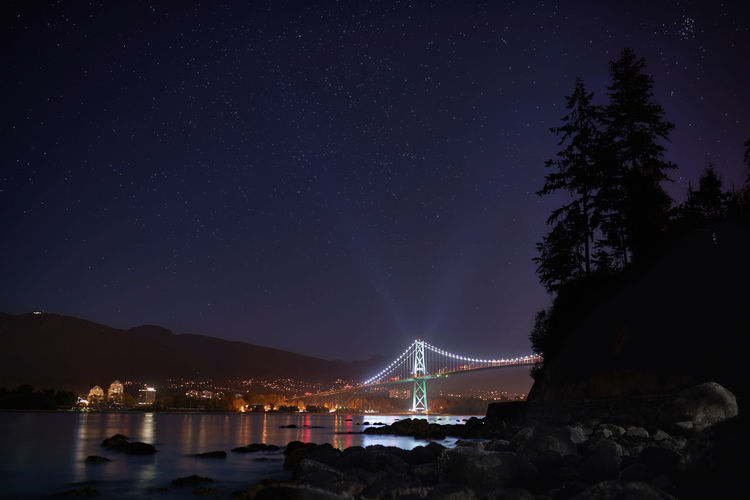 Low Angle View Of Lions Gate Bridge Over Burrard Inlet At Night