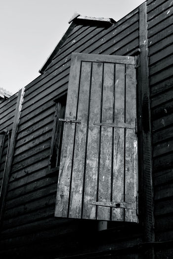 Architecture Black And White Building Exterior Built Structure Close-up Day Fishing Fishing Village Hastings Low Angle View No People Outdoors Photographer Wood - Material Wooden Building Wooden Texture