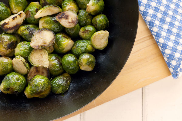 Sautéed Brussels Sprouts wok. Green Green Color Roasted Brussel Sprouts! Vegetarian Vegetarian Food Blue Napkin Braised Brussels Sprout Close-up Cruciferous Cutting Board Food Food And Drink Freshness Green Color Healthy Eating Healthy Lifestyle No People Roasted Studio Photography Vegan Vegan Food Vegetable Wok Wooden Background