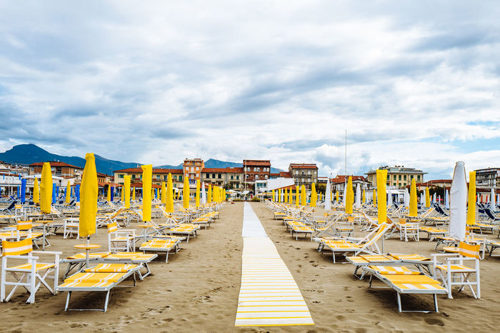 Camaiore Tuscany Absence Architecture Beach Beauty In Nature Cloud - Sky Day Empty In A Row Italy Nature No People Outdoors Sand Sea Sky Tranquility Water Yellow Paint The Town Yellow