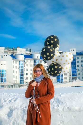 Building Exterior One Person Young Women Architecture Winter Young Adult Cold Temperature Standing Real People Built Structure Leisure Activity Snow Front View Clothing Lifestyles City Three Quarter Length Looking At Camera Warm Clothing Beautiful Woman Outdoors Hairstyle Scarf
