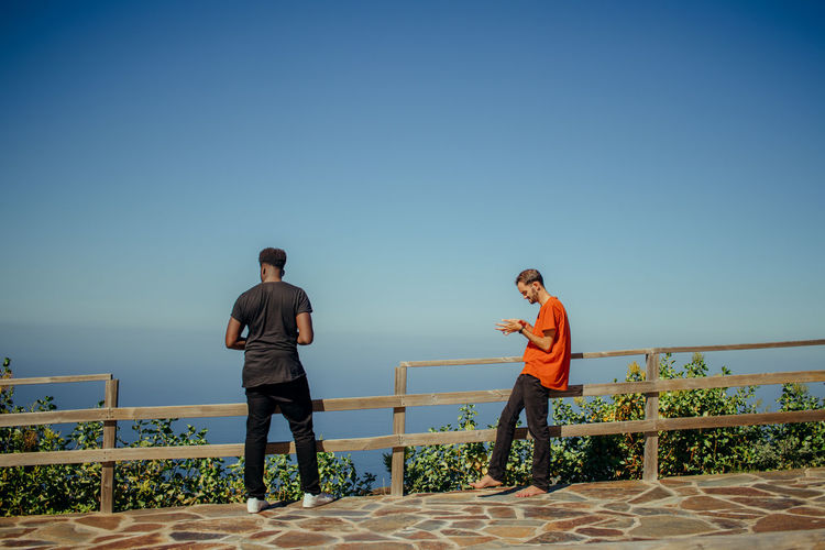 Discovering Tenerife Sky Clear Sky Real People Lifestyles Two People Nature Young Men Casual Clothing Copy Space Outdoors Sunlight Young Adult People Blue Water