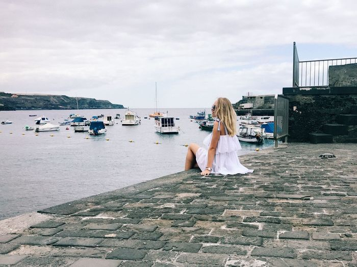 Water Sky Beach Women One Person Real People Nature Sea Land Lifestyles Leisure Activity Cloud - Sky Adult Sitting Rear View Day Incidental People Hair Sand Hairstyle