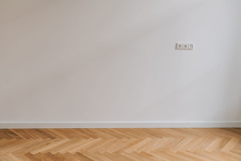 View of empty hardwood floor against wall at home