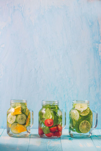 Detox water with vegetables and fruits. Diet healthy eating and weight loss. Detox Airtight Choice Citrus Fruit Container Copy Space Cucumber Food Food And Drink Freshness Fruit Glass - Material Healthy Eating Indoors  Jar No People Still Life Studio Shot Transparent Variation Vegetable Wellbeing