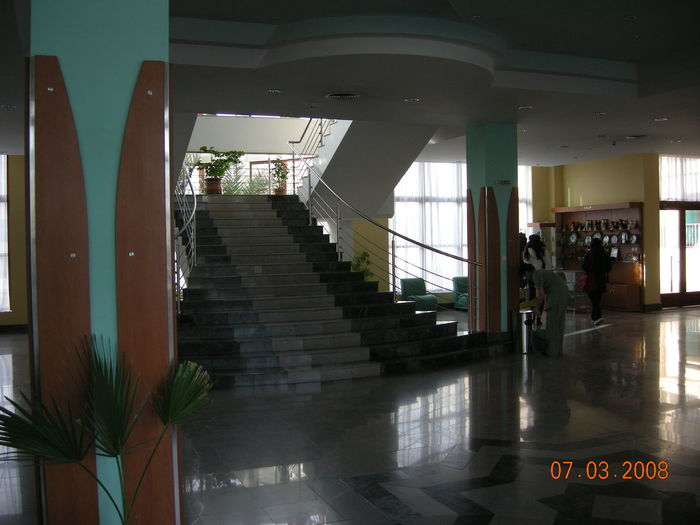 People on staircase in building