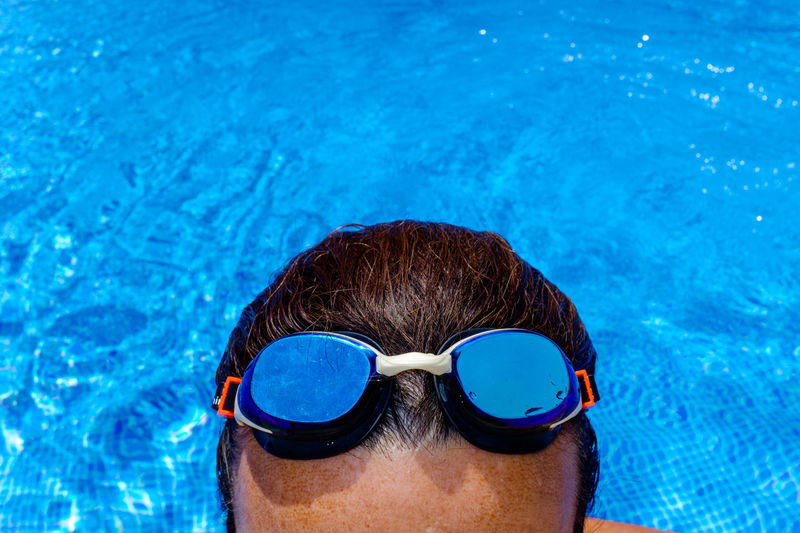 Close-up portrait of man swimming in pool