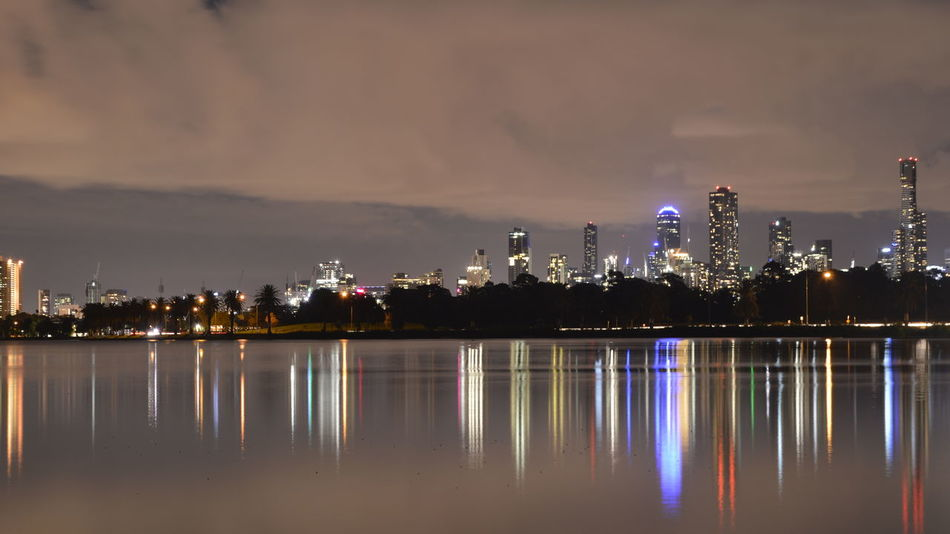 Melbourne reflected on the Albert Park Lake. Tourism Advertisement Melbourne, Australia Melbourne Australia Reflection Water Reflections Albert Park Lake Lake Nightphotography Night Architecture No People No Filters  Cities At Night Waterfront Calm Standing Water Lakeshore Lakeside Office Building Skyline Building Amusement Park Ride Skyscraper Financial District  Tower Tall - High