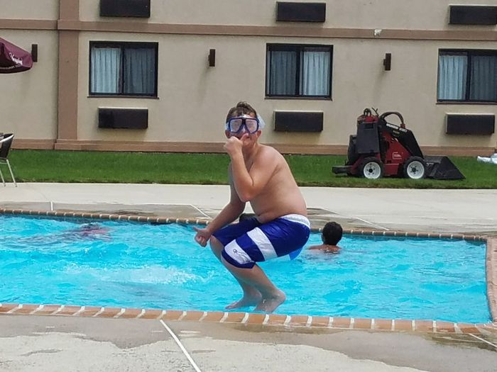 Jumping in the pool Swimming Pool Swimming Summer Fun Boy Water Sport Exercising Outdoors One Boy Jumping In The Pool Goggles Thumbs Up Happy Smile Swimming Trunks Sommergefühle Mix Yourself A Good Time