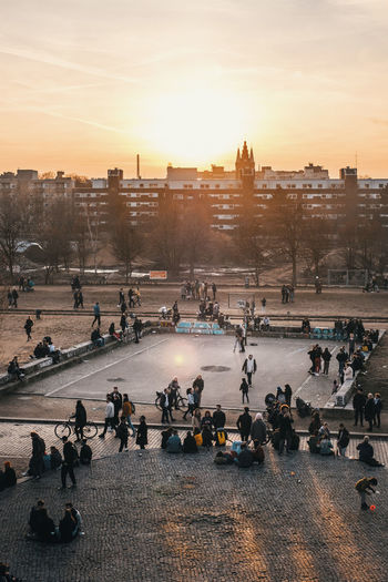 Crowd Large Group Of People Architecture Group Of People Sky Building Exterior Built Structure City Real People Sunset Nature Street High Angle View Women Lifestyles Men Travel Transportation Water Sun Outdoors