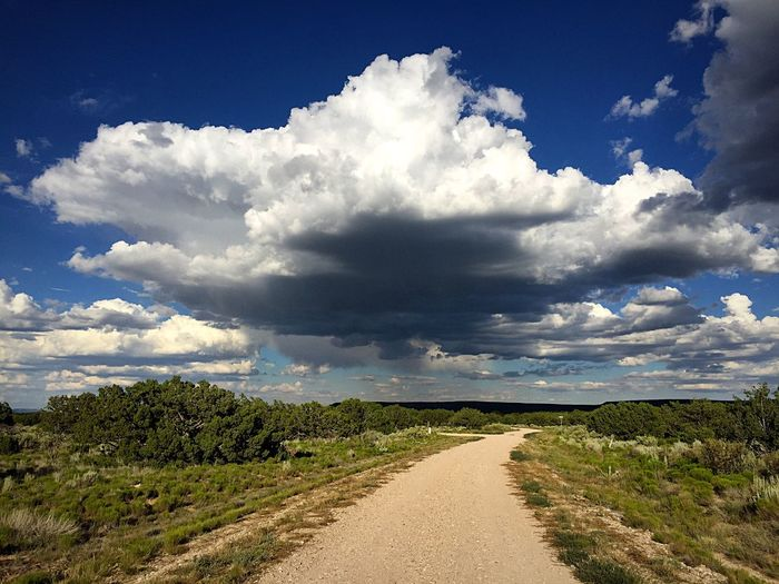 """""""The Ceiling"""" A rural road in The Central Highlands of New Mexico, USA, leads under the ceiling of a magnificent cloud. Ceiling Cloud Clouds And Sky Cloudscape Rural Ruralroad Afternoon Sky Newmexicoskies Newmexico Newmexicophotography Cloudformation Country Road"""