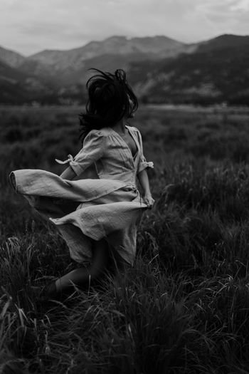 Grass Plant One Person Field Land Nature Leisure Activity Real People Full Length Lifestyles Women Mountain Beauty In Nature Adult Growth Outdoors Hairstyle Free Freedom Run Running Dancing Black And White Blackandwhite Mountains