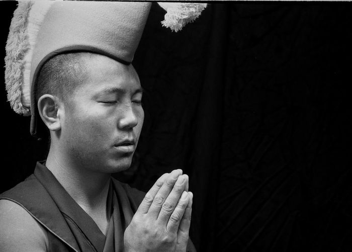 Gyuto Monks of Tibet Black Background Budda Close-up Contemplation Day Front View Gyuto Monks Of Tibet Headshot Human Body Part Indoors  Lifestyles Mid Adult One Person People Suit Tibet Tibetan Buddhism Tourism Travel Travel Destinations Vivid International Young Adult Young Women