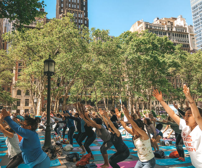 Yoga Group Of People Built Structure Architecture Real People Crowd Building Exterior Tree Men Large Group Of People Nature City Plant Building Day Lifestyles Outdoors Women Arms Raised Human Arm New York City Outdoor Yoga Yoga In The Park
