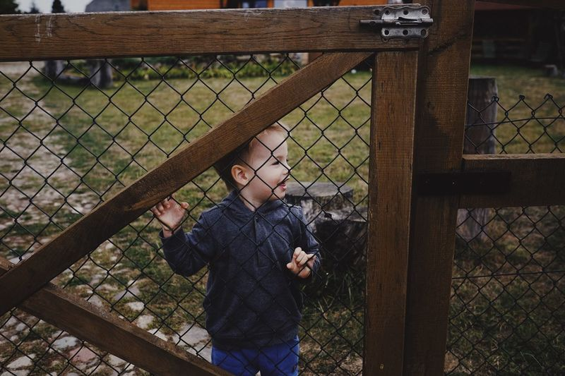 Smile Fun Boy EyeEm Selects Real People Fence One Person Boundary Chainlink Fence Barrier Leisure Activity