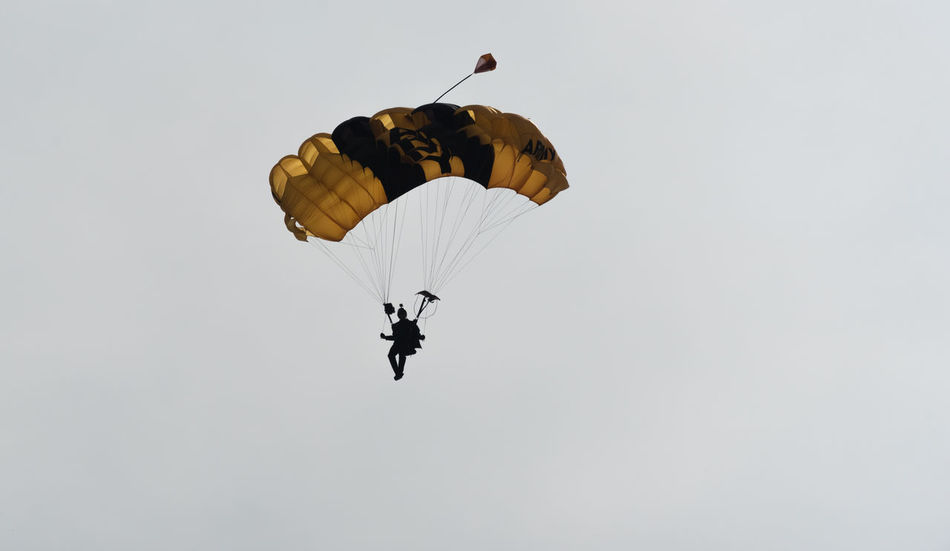 Adventure Day Exhilaration Extreme Sports Flying Full Length Leisure Activity Lifestyles Low Angle View Men Mid-air Outdoors Parachute Paragliding People Real People Sky Skydiving Sport Stunt Person Unrecognizable Person
