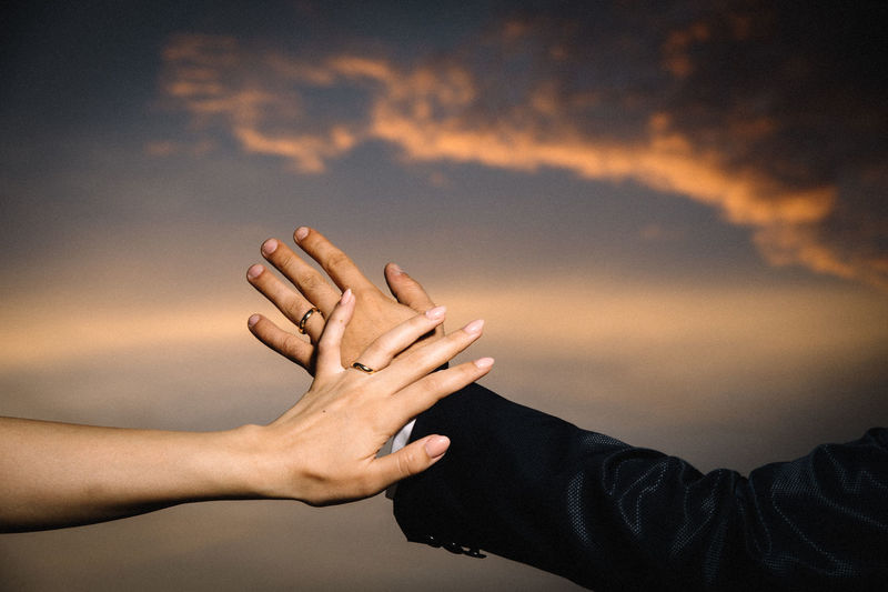 Adult Body Part Bonding Cloud - Sky Couple - Relationship Finger Friendship Hand Human Body Part Human Hand Human Limb Human Relationship Leisure Activity Lifestyles Men Nature People Positive Emotion Real People Sky Sunset Togetherness Women