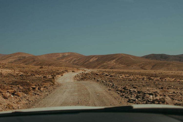Road trip, Fuerteventura Fuerteventura Arid Climate Car Car Interior Car Point Of View Clear Sky Climate Environment Land Vehicle Landscape Mode Of Transportation Motor Vehicle Mountain Nature No People Non-urban Scene Outdoors Road Sky Transportation Windshield