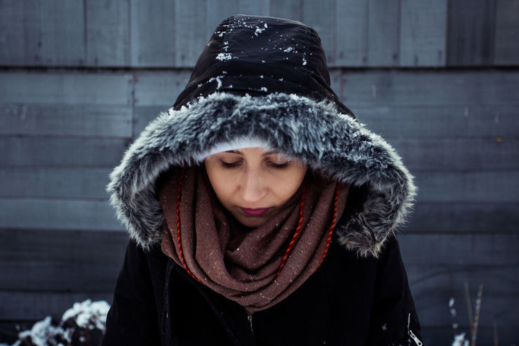 Young woman wearing warm clothing during winter