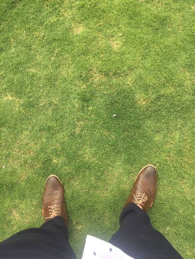 Low Section Shoe Human Leg Real People One Person Body Part The Photojournalist - 2018 EyeEm Awards Green Color Human Body Part Personal Perspective Grass Lifestyles Leisure Activity Plant Nature Standing High Angle View Men Day Human Foot Outdoors