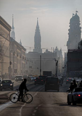 Ludwigstrasse Church Crossing The Street Feldherrnhalle Historical Building Ludwigstraße Mobility In Mega Cities Munich Neues Rathaus Theatinerkirche  Alter Peter Architecture Bicycle Building Exterior Car City Cycling Men People Real People Red Lights Sky Street Transportation Travel Travel Destinations