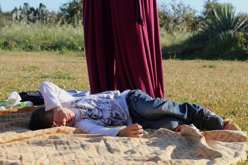 Man lying down on land