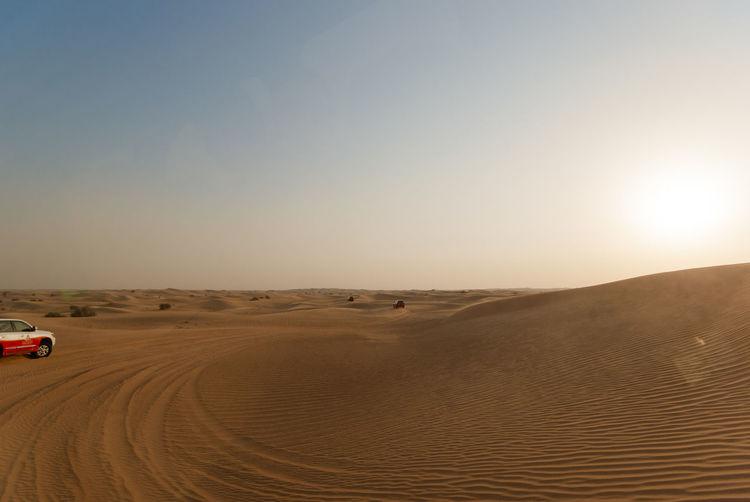 Car At Desert Against Clear Sky