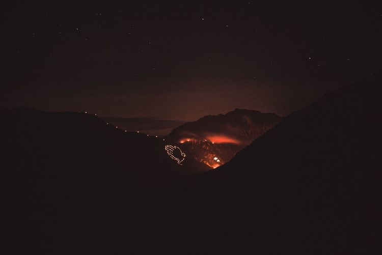 Herzjesufeuer2k18 💪🏻 Skyline Sky Glowing In The Dark Glowing Lighting Hometown Obertilliach Easttyrol Tyrol Austria Tradition Herzjesufeuer Heart Of Jesus Environment Discover Your City Christianity Moutains Burning Night Beauty In Nature Sky Mountain Star - Space Scenics - Nature Nature No People Outdoors Silhouette Star Field Geology The Great Outdoors - 2018 EyeEm Awards EyeEmNewHere