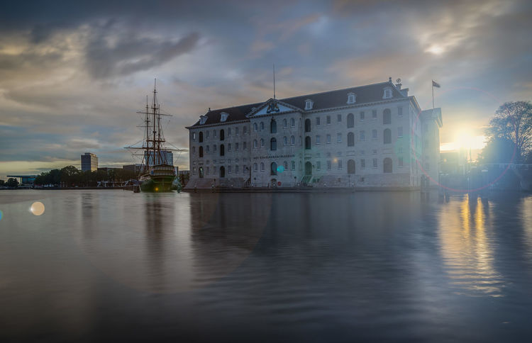 Scheepvaartmuseum Architecture Building Exterior Built Structure City Cloud - Sky Illuminated Nature Nautical Vessel Night No People Outdoors Reflection River Sky Water Waterfront