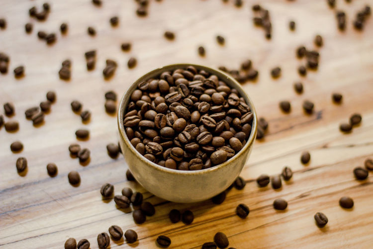 Food And Drink Freshness Food Roasted Coffee Bean Wood - Material Table Coffee - Drink Still Life Brown Large Group Of Objects Indoors  Coffee No People Close-up Abundance High Angle View Seed Drink Roasted Refreshment Caffeine