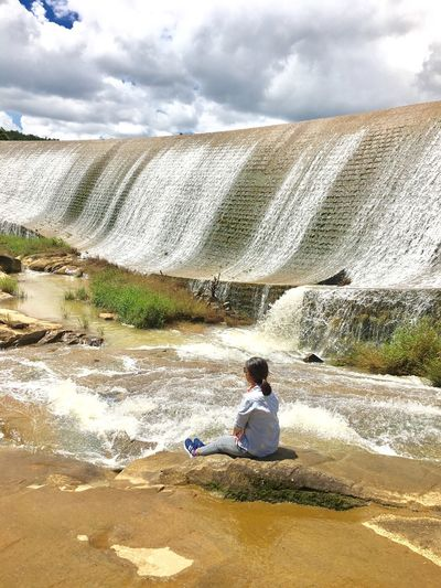 Fall in love with this moment Sitting Travel Travel Photography Anchobi Amazing View White Sunlight One Person Rock Trees Dam Water Sky Moments Of Life Da Lat City Enjoying Life Beauty Alone EyeEmNewHere EyeEm Nature Lover EyeEm Best Shots Still Life Traveling Travel Destination