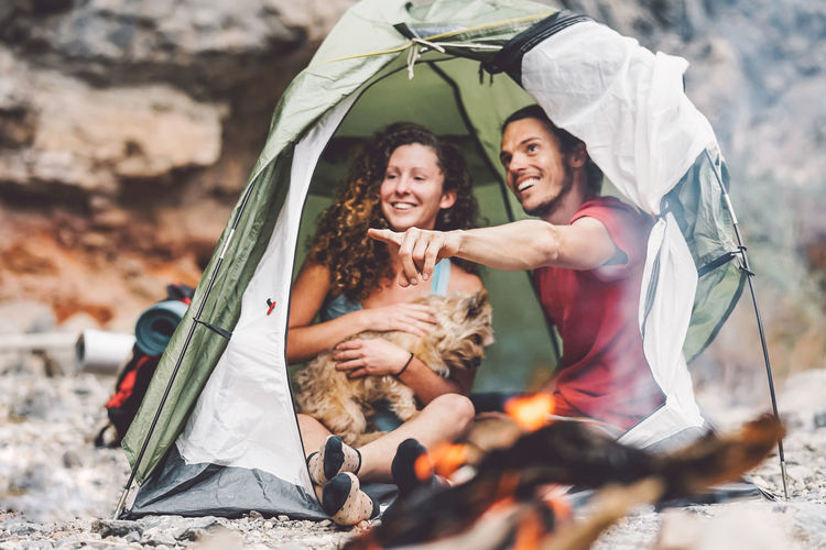 Couple of trekker sitting in the tent with their pet - Happy man and woman having fun in vacation camping around rock mountain next to the fire - Love, travel and relationship concept Adventure Animal Bonfire Campfire Camping Canyon Couple Cuddle Discovery Dog Explore Family Fire Fireplace Flame Forest Fun Girl Happy Hiking Hipsters Holiday Island Journey Lifestyle Love Man Moment Mountain Mountaineering Nature Night Outdoor People Pet Relationship Relax Rock Romance Romantic Tent Travel Traveler Trekker Trekking Trip Vacation Wanderlust Woman Young
