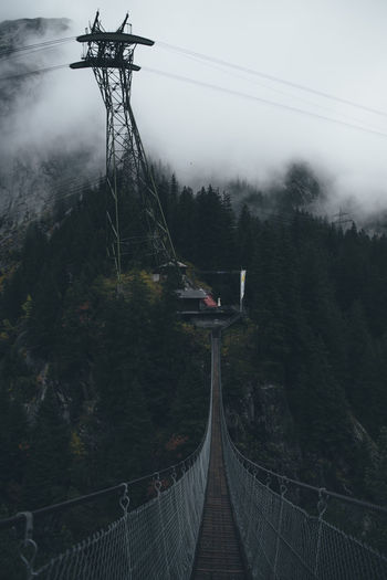Architecture Bridge Built Structure Cable Connection Day Electricity  Fog Nature No People Outdoors Plant Power Supply Railing Scenics - Nature Sky Technology Tranquil Scene Tranquility Transportation Tree