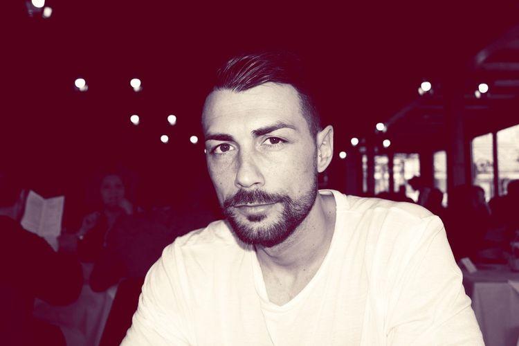 Portrait of handsome man sitting in restaurant