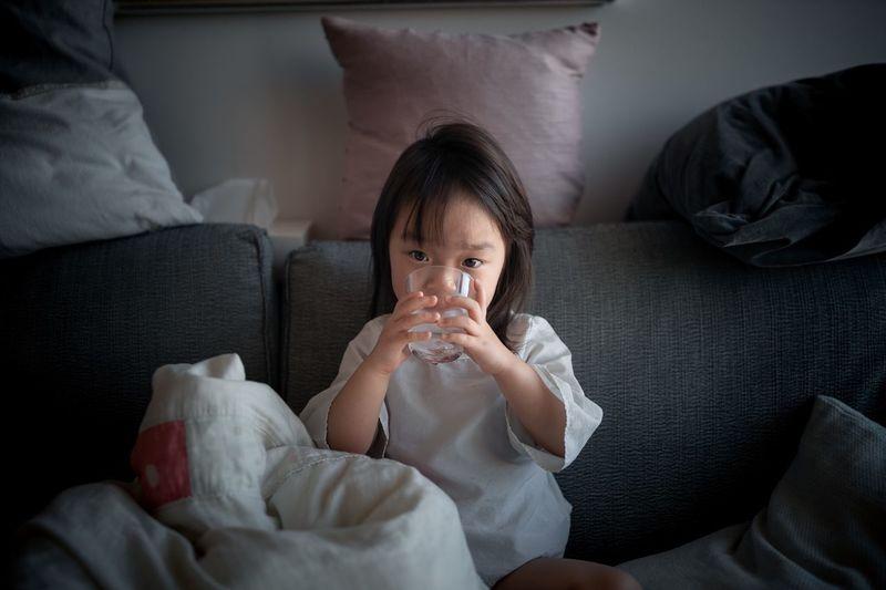 Portrait of a girl sitting on sofa