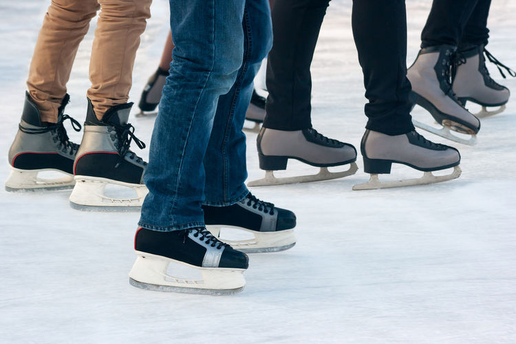Low section of people skating on ice