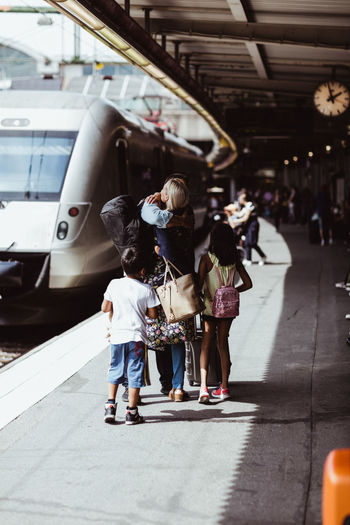 People walking on railroad station