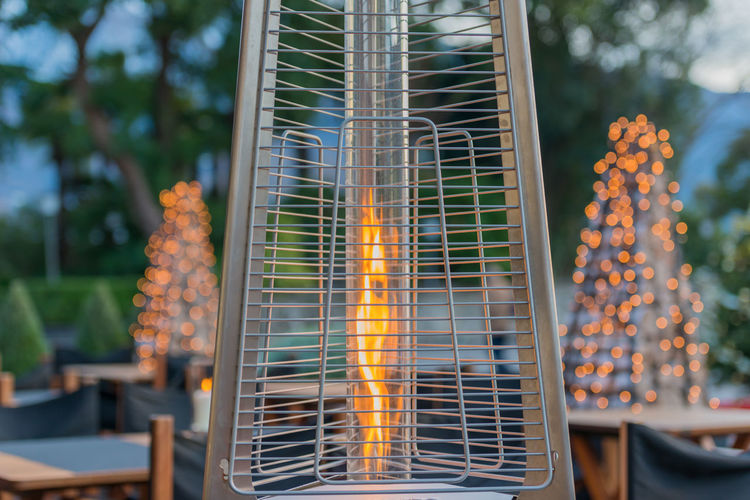 Modern Heating System with Fire Burning Creativity Gas Modern Tranquility Tree Close Up Color Day Fire Firework - Man Made Object Firework Display Focus On Foreground Full Frame Grate Heating Heating System Illuminated Metal No People Outdoors Technology Tranquil Scene