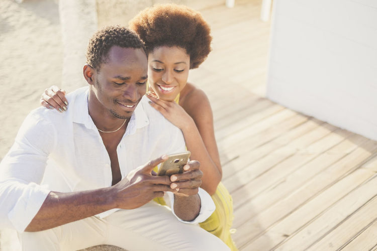 Young couple holding smart phone