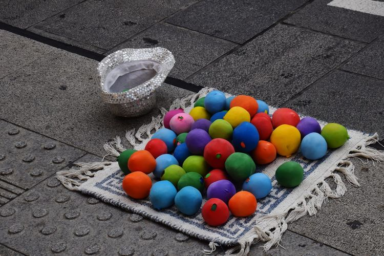 High angle view of multi colored balls on street