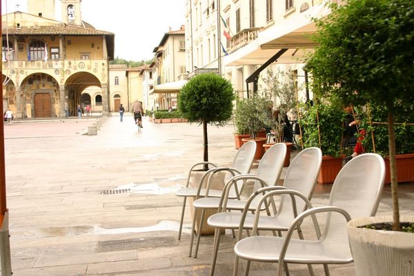 Garden Chair Medieval Medieval Architecture Tuscany Cityscape Holiday Travel Italian Piazza Cafe Wet Street Rain Rainy Chair Architecture Table Built Structure Sidewalk Cafe Building Exterior Outdoors Day