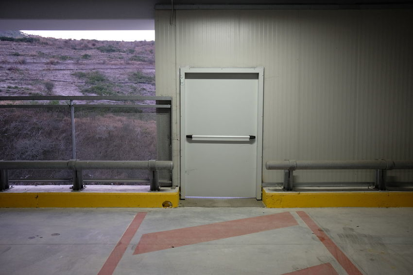 covered parking mall with security exit Parking Lot Security Shopping Architecture Built Structure Concrete Day Door Empty Entrance Exit Garage Indoors  Interior Lot Mall No People Parking