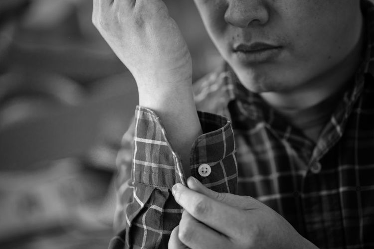 Button up Button Button Up EyeEmNewHere Button Adult Black And White Close-up Day Focus On Foreground Holding Human Hand Leisure Activity Lifestyles Men One Person Outdoors People Real People Shirt Young Adult