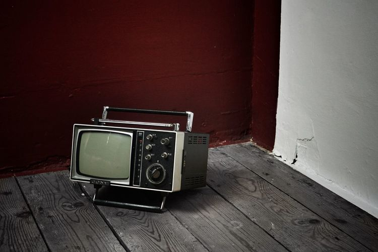 the evil seduction of images....... Still Life The Past Antique Single Object History Television Set Wall - Building Feature Analog Old Indoors  Retro Styled Screen Technology Classic Monitor Anachronism Alone... Isolation Obsolete Technology Obsolete Television Tv