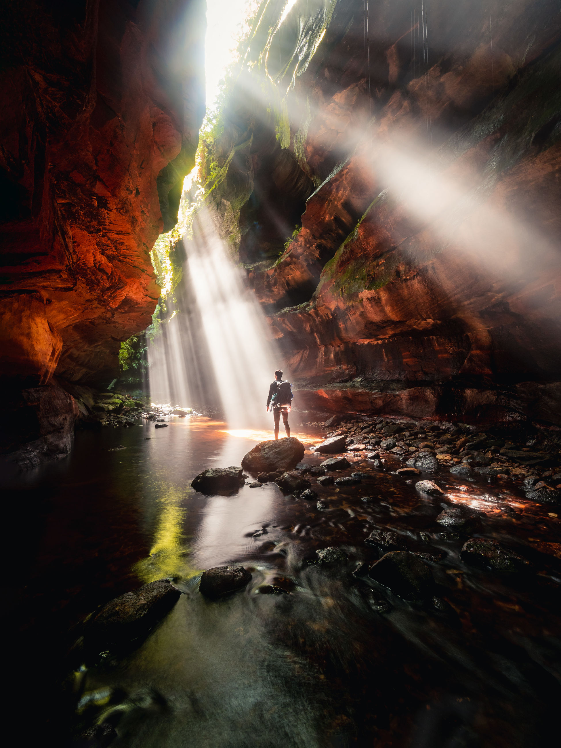 water, waterfall, motion, nature, scenics - nature, one person, rock - object, rock, long exposure, solid, beauty in nature, flowing water, real people, day, forest, rock formation, outdoors, leisure activity, flowing