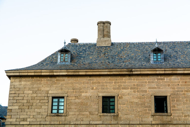 Architecture Brick Wall Building Building Exterior Built Structure Chimney Exterior Façade High Section Historic Historical Building Low Angle View Medieval No People Old Old Buildings Outdoors Roof San Lorenzo De El Escorial Windows