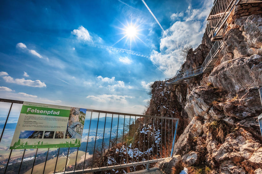 Felsenpfad Sonnenlicht Sonnenstrahlen Architecture Beauty In Nature Cloud - Sky Communication Day Hohe Wand Lens Flare Low Angle View Mountain Nature No People Outdoors Rock Sign Sky Sun Sunbeam Sunlight Text