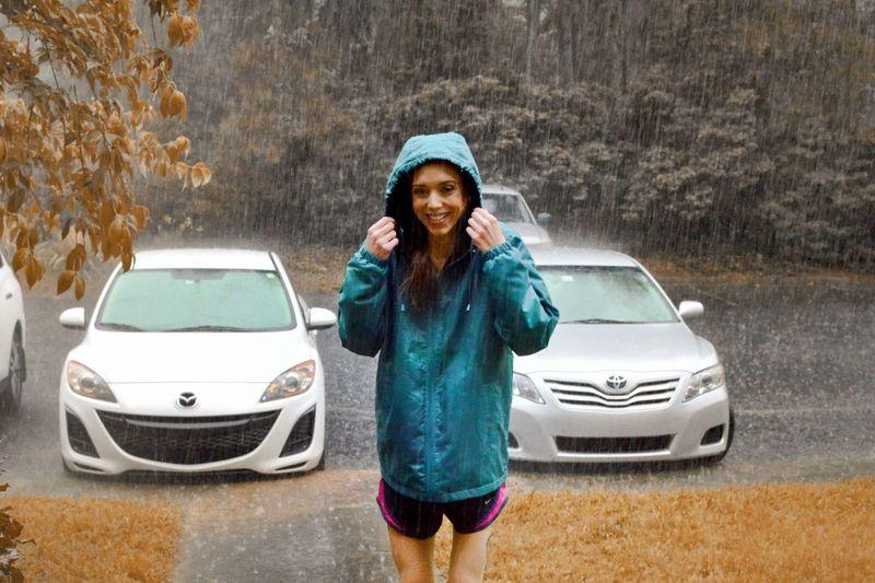 Portrait Smiling Spraying Standing Looking At Camera Water Car Wet Women Cheerful Rainy Season Rain Umbrella Raincoat Torrential Rain